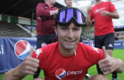 Soccer player no-vision headgear flashing two thumbs up